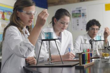 female pupil conducting a science experiment